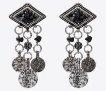 marrakech diamantförmige ohrringe aus silberfarbenem zinn mit quasten