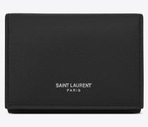 saint laurent paris schlüsseletui aus schwarzem leder mit grain de poudre struktur