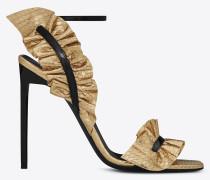 goldfarbene und schwarze edie 110 sandale mit slingbackriemen