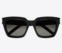 bold 1 sonnenbrille mit glänzend schwarzem acetat-gestell und grauen gläsern mit farbverlauf