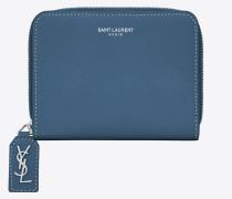 Kompaktes Rive Gauche Portemonnaie aus denimblauem Narbenleder mit Reißverschluss