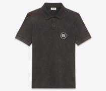poloshirt aus schwarzem baumwollpiqué mit badge mit ausgebleichter optik