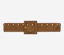 gürtel aus cognacfarbenem velours und goldfarbenem vintage-metall mit y-nietenbesatz
