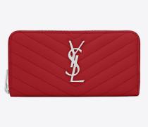Monogramme Portemonnaie aus rotem Strukturleder mit Matelassé-Nähten und Rundumreißverschluss