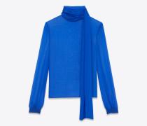 Bluse aus hellblauem Mousselin mit Lavallière-Kragen und Oversize-Ärmeln mit Raffung