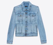jeansjacke aus ausgebleichtem blauem denim mit schwarzen tupfen