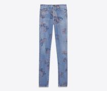 slim fit jeans aus ausgeblichenem, blauem denimstoff mit blumenprint