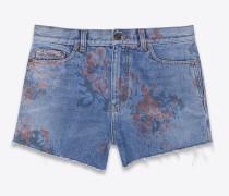 baggy shorts aus ausgeblichenem, blauem denim mit blumenprint