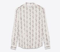 Bluse aus cremeweißer Baumwollgaze mit Ikatprint und Bandkragen