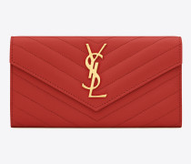großes monogram portemonnaie mit überschlag aus rotem matelassé-leder mit grain de poudre struktur