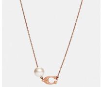 Modellierte Perlen-Halskette mit Signaturplakette
