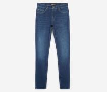 Dark blue slim jeans with leather pocket