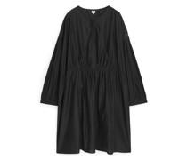 Weites Cupro-Kleid