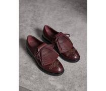Nietenbesetzte Loafer aus Leder mit Kiltie-Fransen und Schnürverschluss