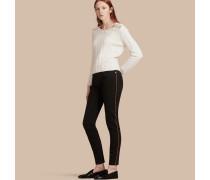 Skinny-Jeans aus Stretchdenim mit Paspelierung