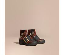 The Buckle Boot aus Natternleder und gummiertem Leder