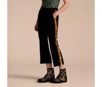 Schmal geschnittene Hose mit kürzerer Beinlänge und Pythonmuster