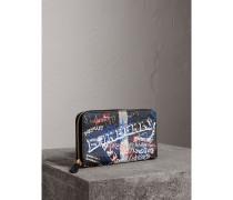 Brieftasche aus Canvas mit Doodle-Motiv und umlaufendem Reißverschluss