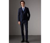 Dreiteiliger Travel Tailoring-Anzug aus Wolle in schmaler Passform