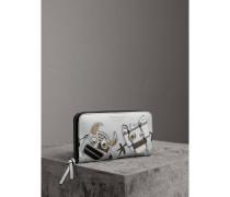 Brieftasche aus Metallic-Leder mit witziger Applikation