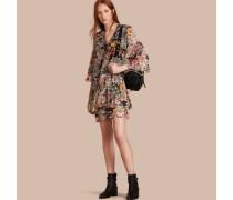 Seidenkleid mit floralem Muster und Raffungen an den Ärmeln