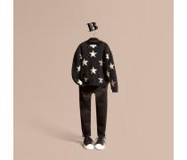 Ein Pullover aus strukturiertem Kaschmir im Karodesign mit Sternenmuster