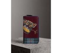 Brieftasche aus Leder mit umlaufendem Reißverschluss und witziger Applikation