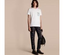 Baumwoll-T-Shirt mit Pyjamastreifenmuster an der Tasche