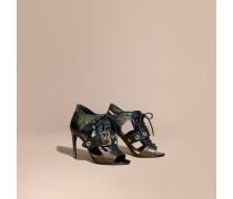 Stiefeletten aus Leder und Natternleder mit Aussparungsdetail und Schnalle