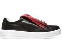 Nietenbesetzte Sneakers aus zweifarbigem Leder