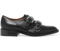 Nietenbesetzte Brogues aus schwarzem Leder