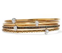 Set Aus Vier Goldfarbenen Armbändern Mit Verzierung