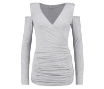 Cutout shoulder wrap-effect jersey top
