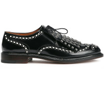 Fringed Studded Glossed-leather Brogues