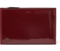 Paneled glossed and smooth leather clutch
