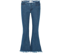 Frayed low-rise flared jeans