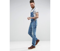 Jeans-Latzhose in hellblauer Vintage-Waschung und Retro-Tasche auf der Vorderseite Blau