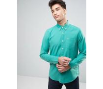 Schmal geschnittenes, elastisches Oxford-Hemd mit Knopfleiste und Seagull-Logo in Grün Grün