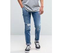 Skinny-Jeans in mittlerer Vintage-Waschung mit Zierrissen Blau