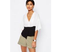 Kurze Bluse mit schwarz-weißem Farbblockdesign Weiß