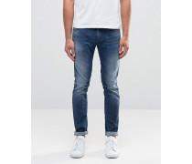 Superenge Jeans in Used-Optik und mittelblauer Waschung Blau
