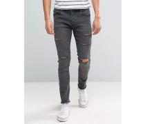 Skinny-Jeans mit Fransensaum und Rissen Grau