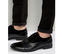 Oxford-Schuhe aus schwarzem Kunstleder mit Detail in Wildlederoptik Schwarz