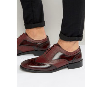 Schuhe im Budapester Stil aus weinrotem Leder Rot