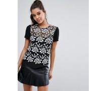 T-Shirt aus schwerer Spitze mit farblich abgesetzten Ärmeln Schwarz