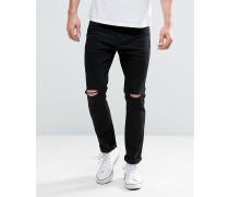 Eng geschnittene schwarze Jeans mit Knierissen Schwarz