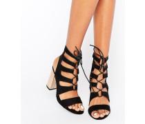 Geschnürte Sandalen mit Metallic-Absatz Schwarz