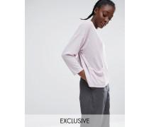 Pullover mit Tasche und Schlitz hinten Violett