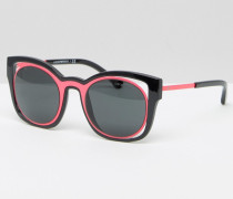 Katzenaugen-Sonnenbrille mit Cutout in rosa Kontrastoptik Schwarz