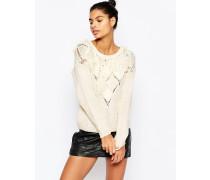 Oversize-Pullover mit Quasten und Lammfell Cremeweiß